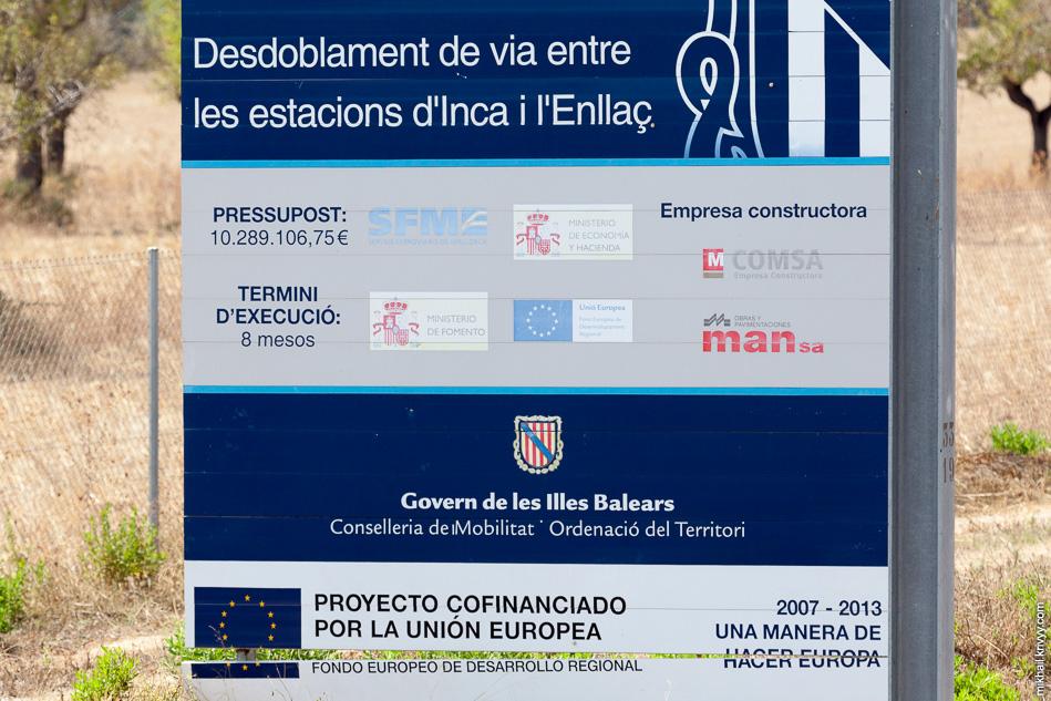 Информационный плакат на станции Эньяс (Enllaç).